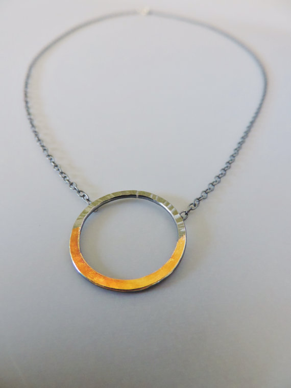 bold and unique designed hoop necklace of dark silver and gold mixed metals designed for women