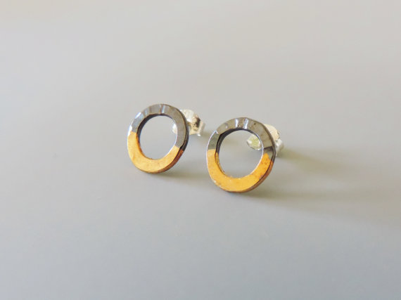 bold and elegant dark silver and gold mixed metal hoop studs