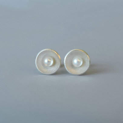 unique dainty silver and pearl earrings deigned for the bride
