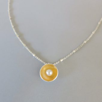 dainty and elegant mixed metal pearl necklace designed for women