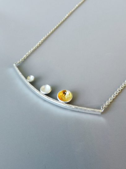 unique and contemporary necklace designed for women sterling silver and gold mixed metal jewelry