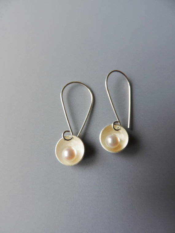 elegant and minimal silver and pearl earrings designed for the bride