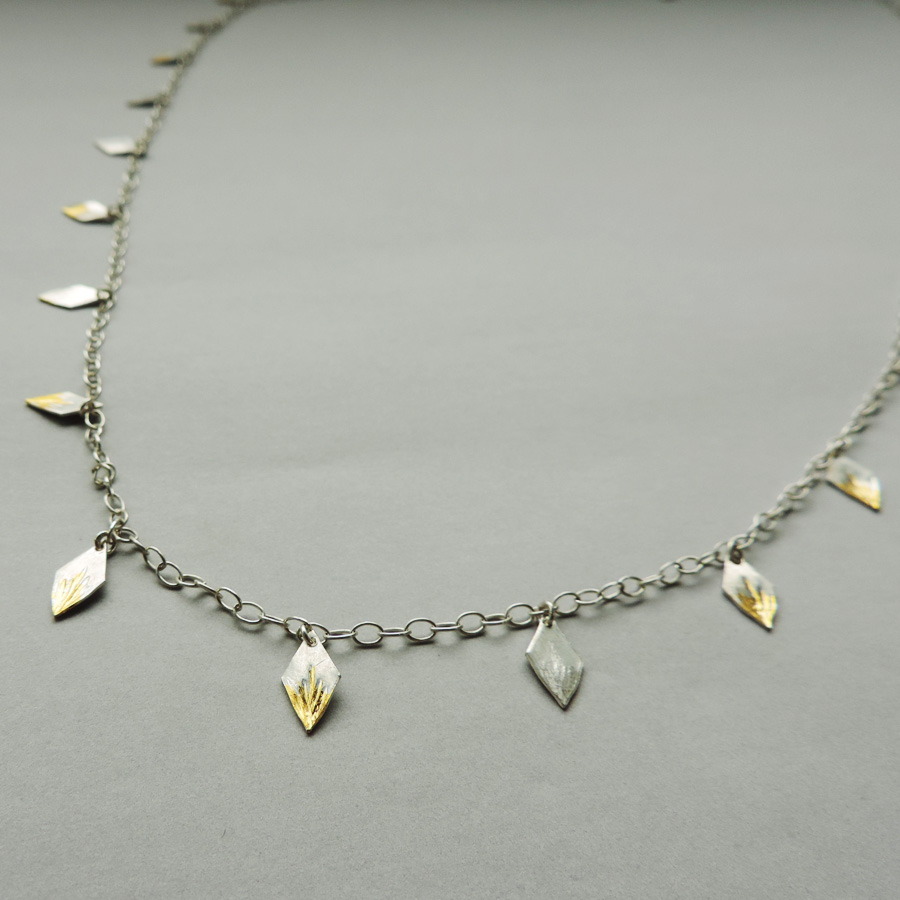 handcrafted wrap necklace in silver and gold mixed metals for everyday wear