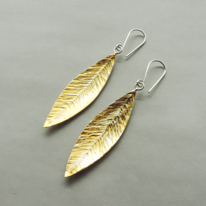 handmade silver and gold feather earrings designed for women for everyday wear