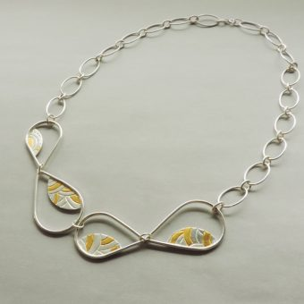 handmade silver and gold statement necklace designed for women