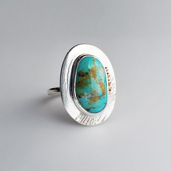 seafoam sierra nevada turquoise modern ring in silver and gold by McKenzie Mendel at her Bend Oregon jewelry store