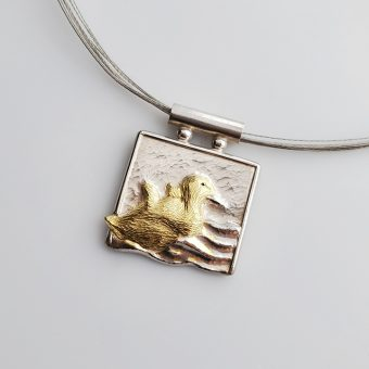 Unique duck necklace in silver and gold